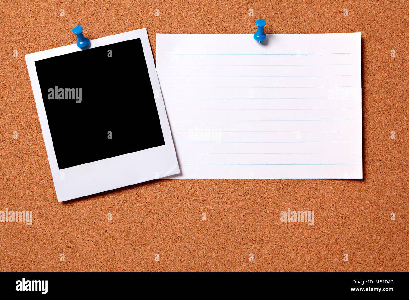 Blank photo print and office index card pinned to a cork