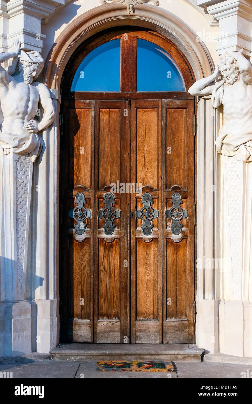Wilanow Royal Palace, Richly ornamented door with atlants baroque  WARSAW, POLAND - JANUARY 13, 2008 Stock Photo