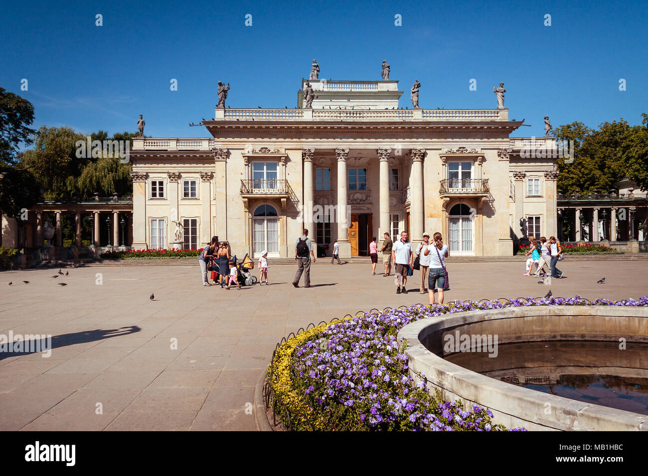 Popular tourist attraction Lazienki Royal Baths Park, fountain at the Palace on the Water WARSAW, POLAND - AUGUST 20, 2009 - Stock Image