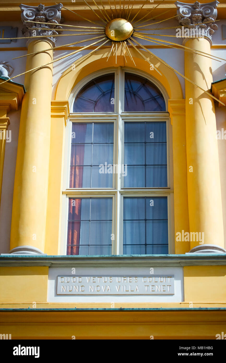 WARSAW, POLAND - SEPTEMBER 13, 2009: Wilanow Royal Palace front facade window with golden Sun rays. Latin inscription QUOD VETUS URBS COLUIT Stock Photo