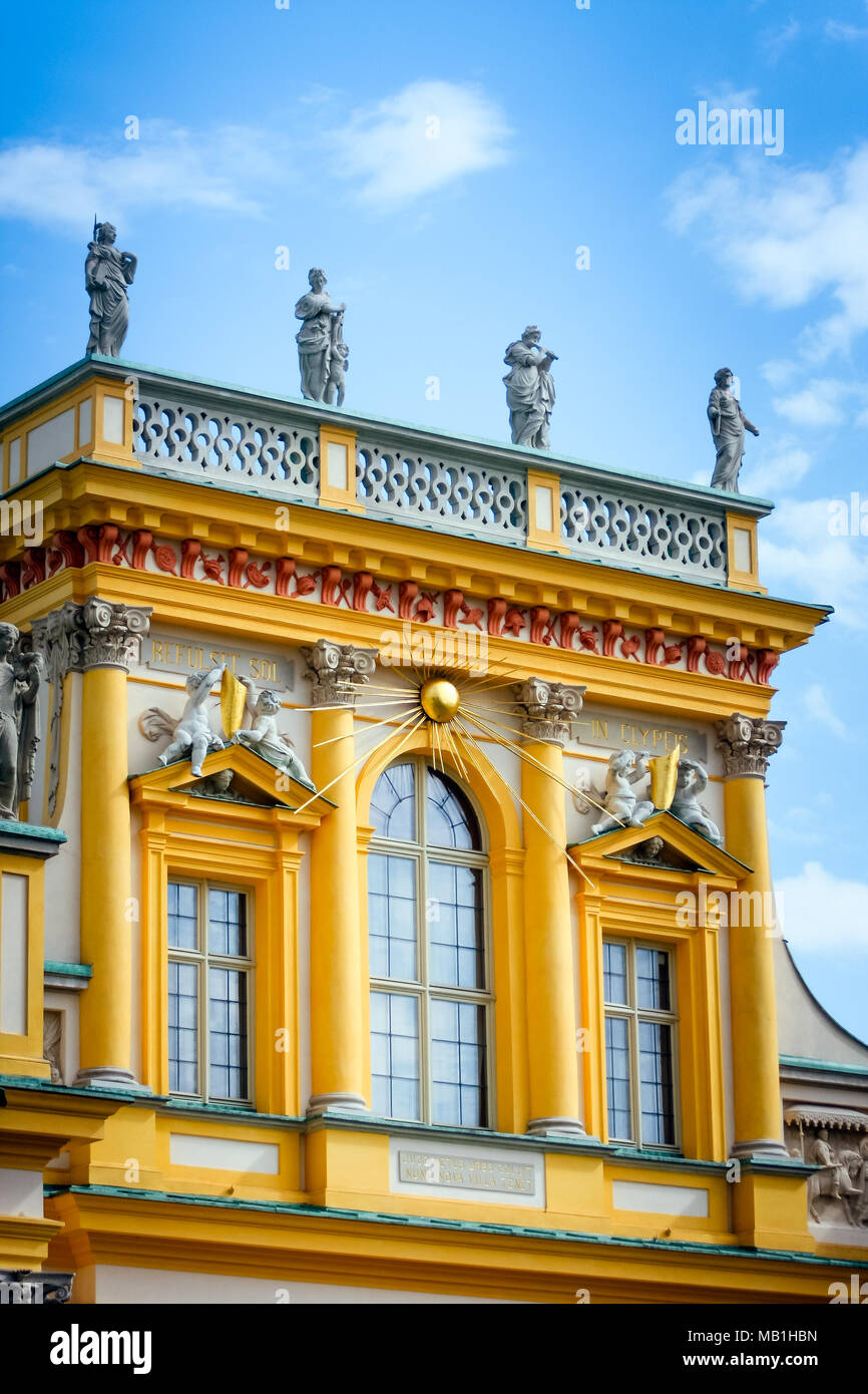 Wilanow Royal Palace central yellow facade part architectural details with golden Sun rays WARSAW, POLAND - SEPTEMBER 13, 2009 Stock Photo