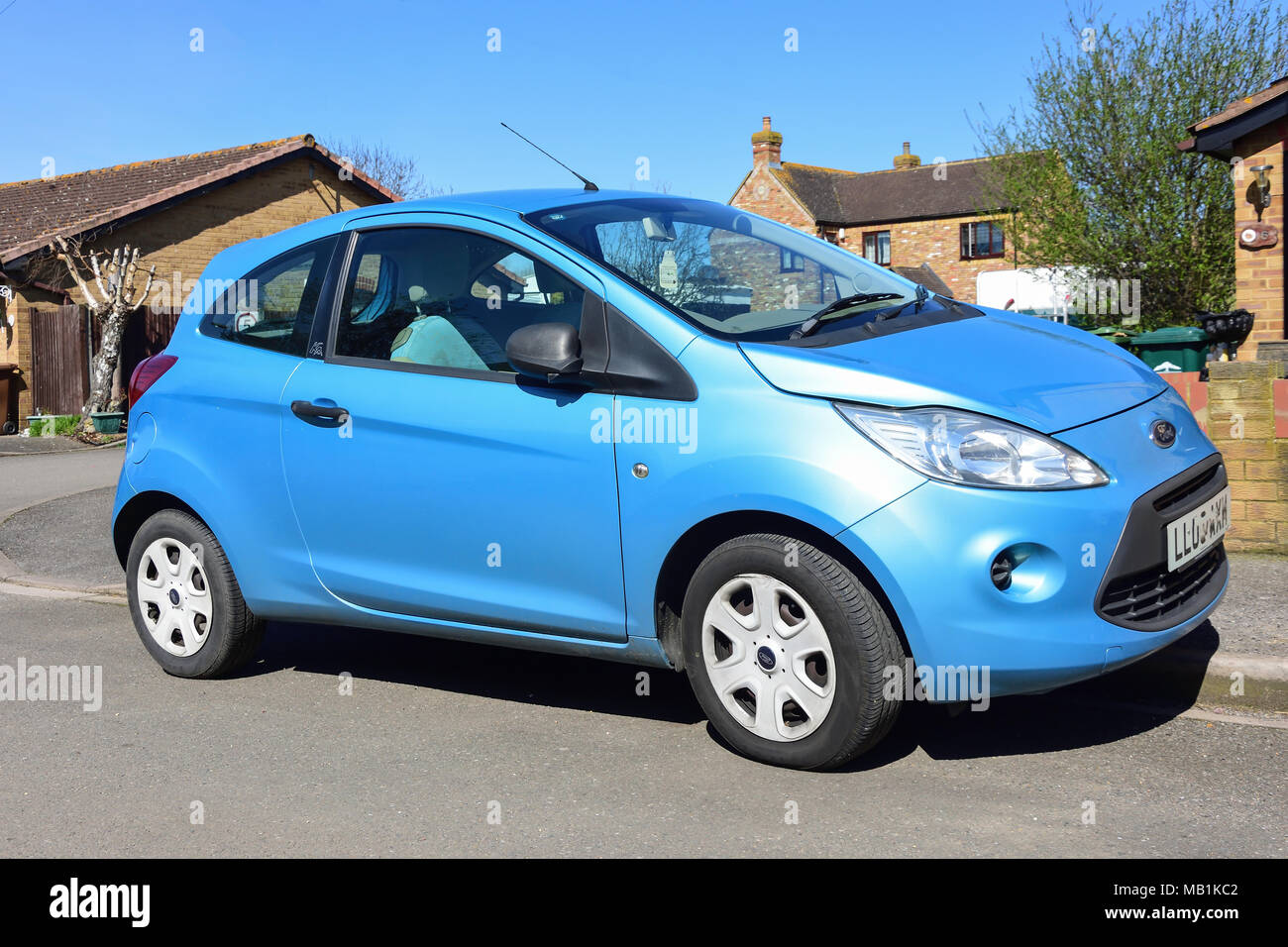 Light blue Ford Ka automobile parked on road, Stanwell Moor, Surrey, England, United Kingdom - Stock Image