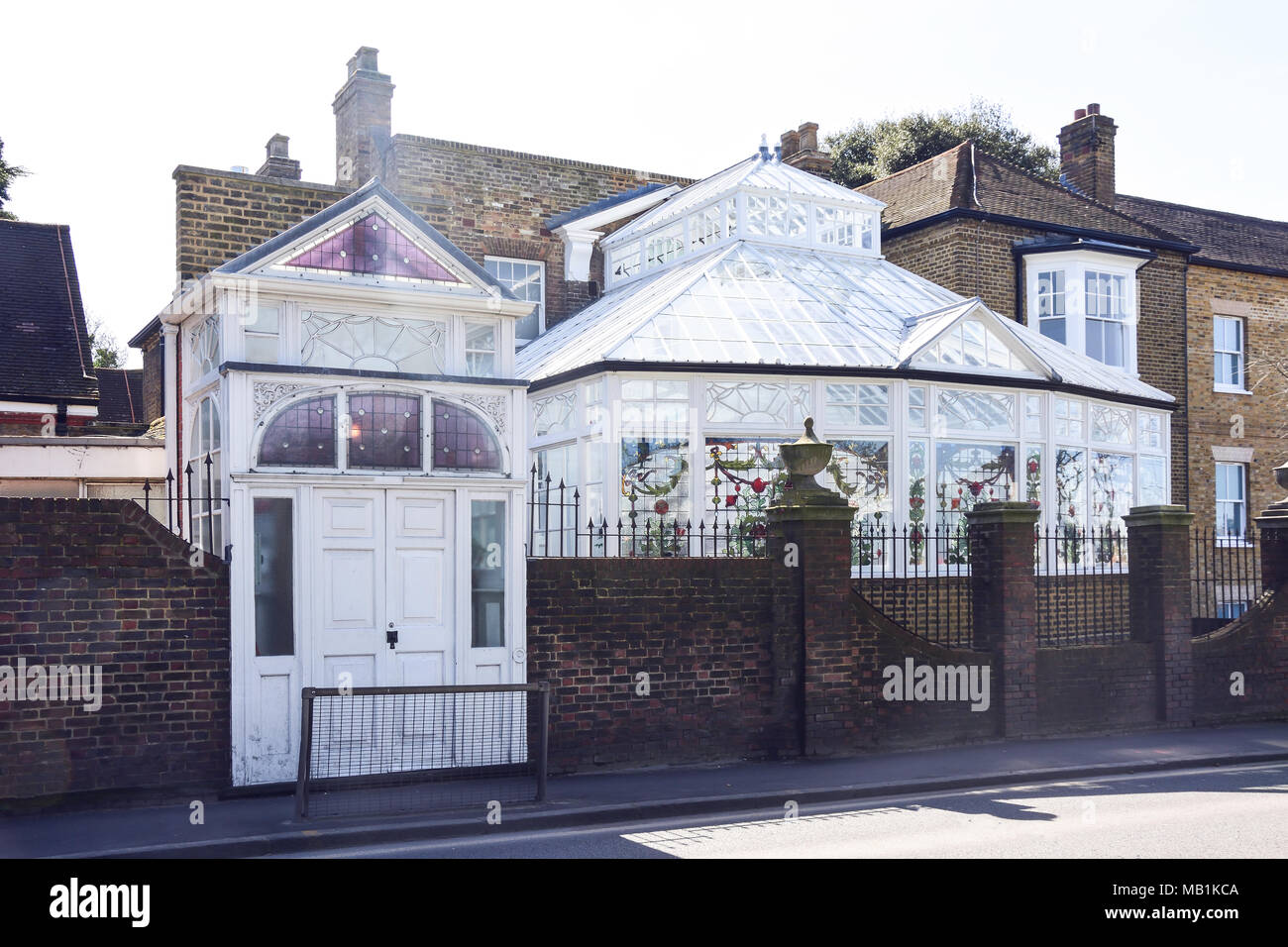 Historic house with glass coservatory on Staines Road, Bedfont, London Borough of Hounslow, Greater London, England, United Kingdom - Stock Image