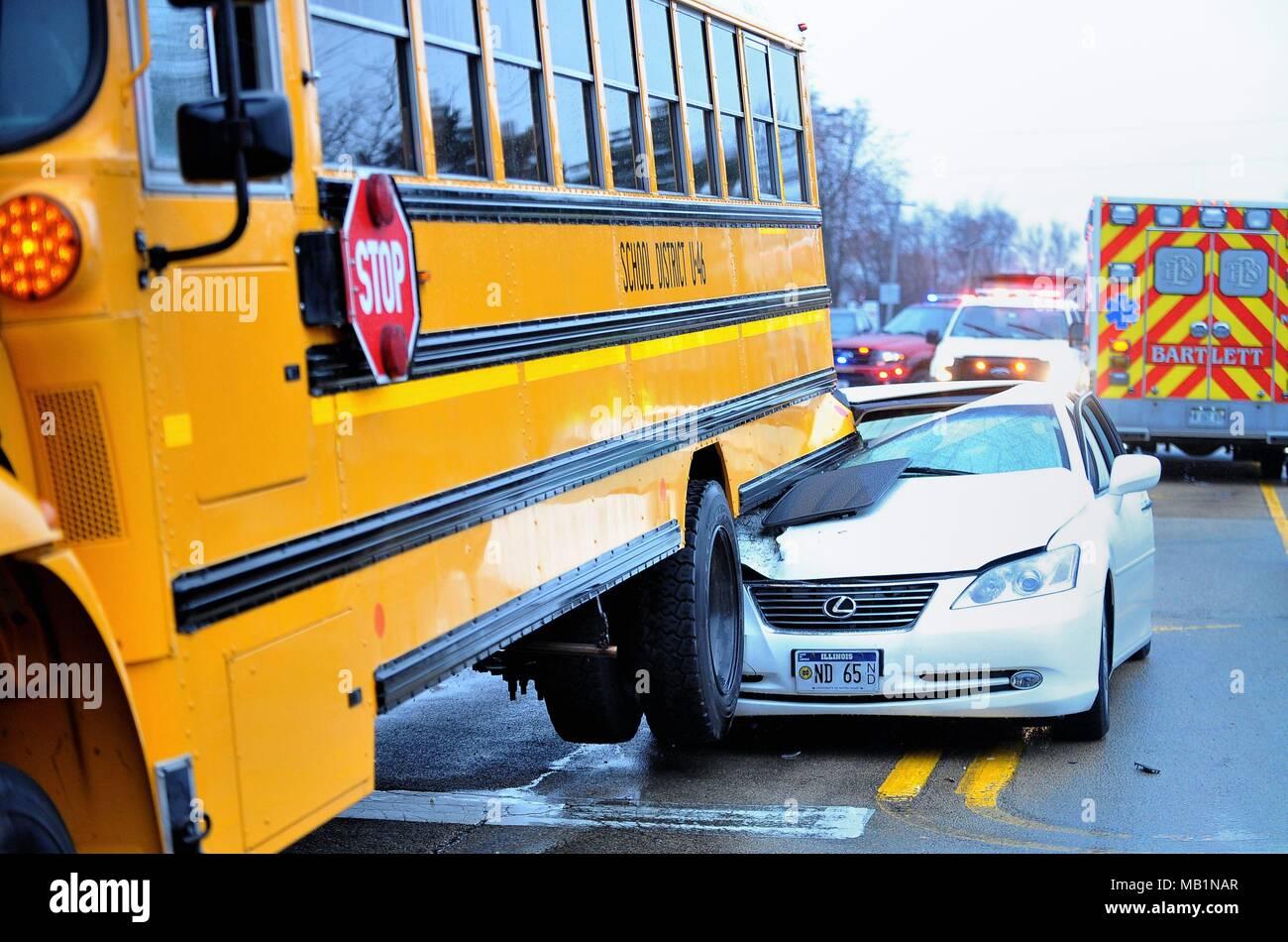 Bartlett, Illinois, USA. School bus was rear ended with sufficient force to lift the bus' reat wheels off the road. - Stock Image
