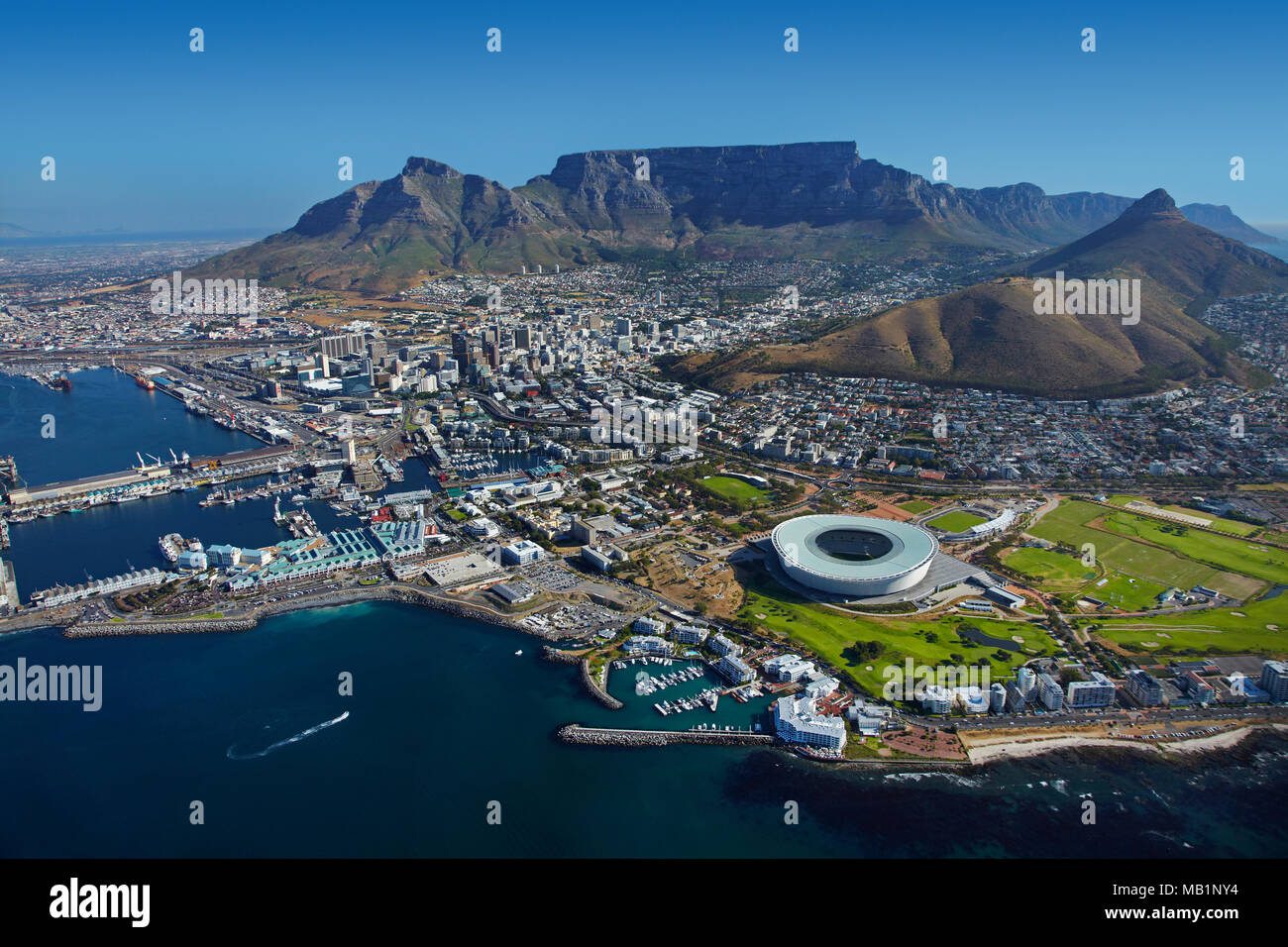 Cape Town Stadium, V & A Waterfront (left), and Table Mountain, Cape Town, South Africa - aerial - Stock Image