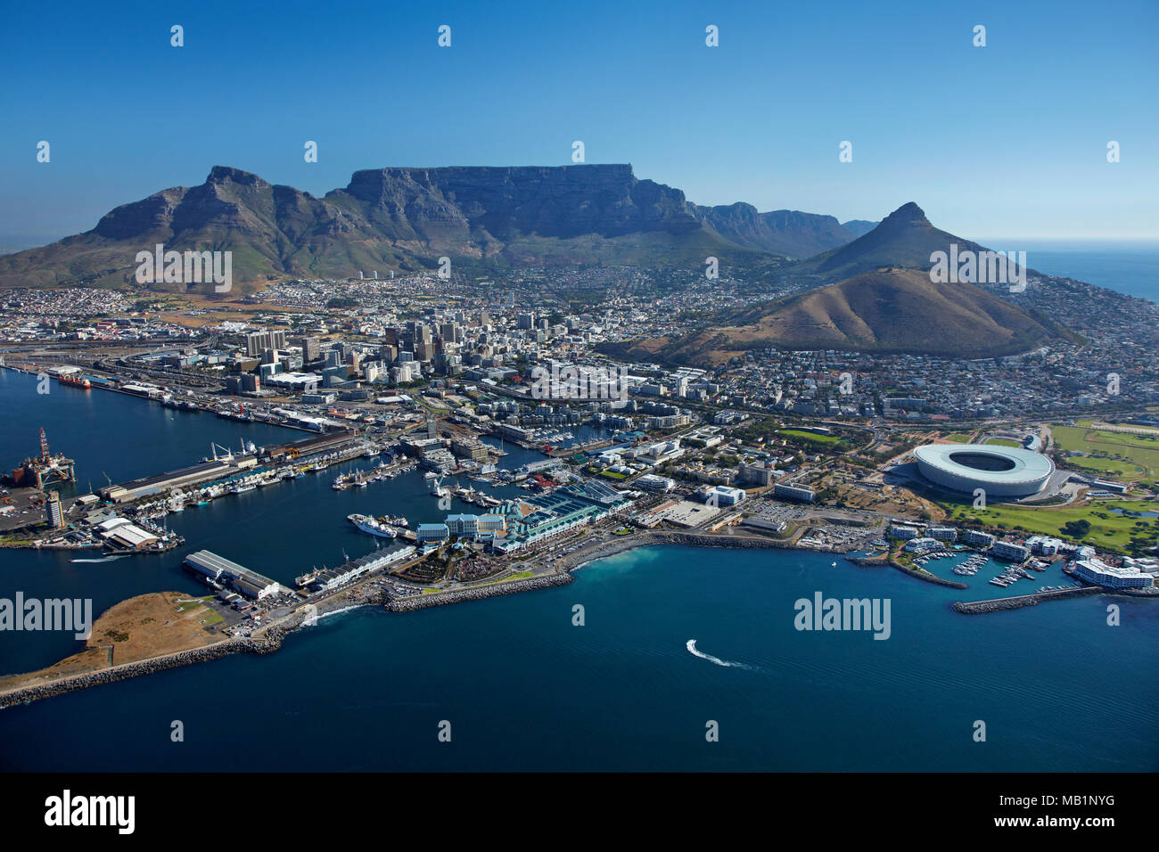 V & A Waterfront, Cape Town Stadium, and Table Mountain, Cape Town, South Africa - aerial - Stock Image