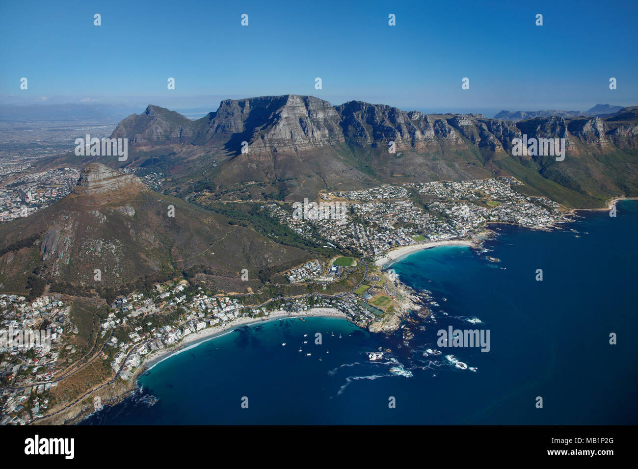Clifton Beach (left) and Camps Bay (right), Table Mountain, and The Twelve Apostles, Cape Town, South Africa - aerial - Stock Image