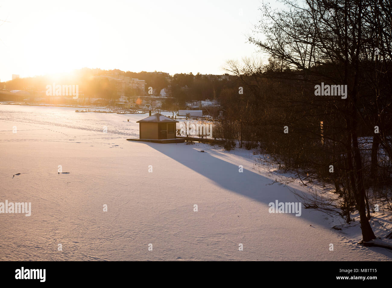 The Golden Hour at Sunrise Over a Frozen Lake in Bromma Sweden - Stock Image