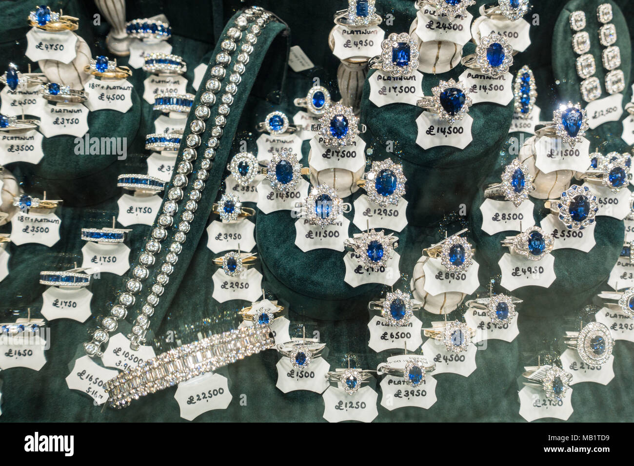 Diamond and sapphire rings with price tags in shop window in Glasgow's Argyll Arcade, Scotland, UK - Stock Image