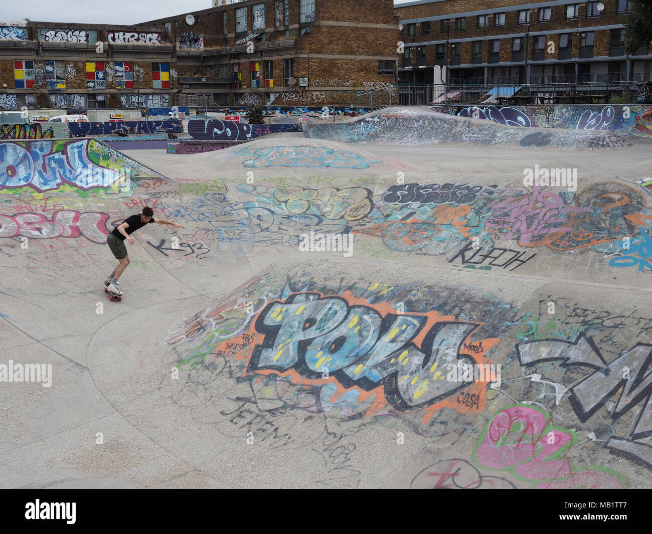 Skateboarder in Stockwell Skatepark, London, England, UK - Stock Image