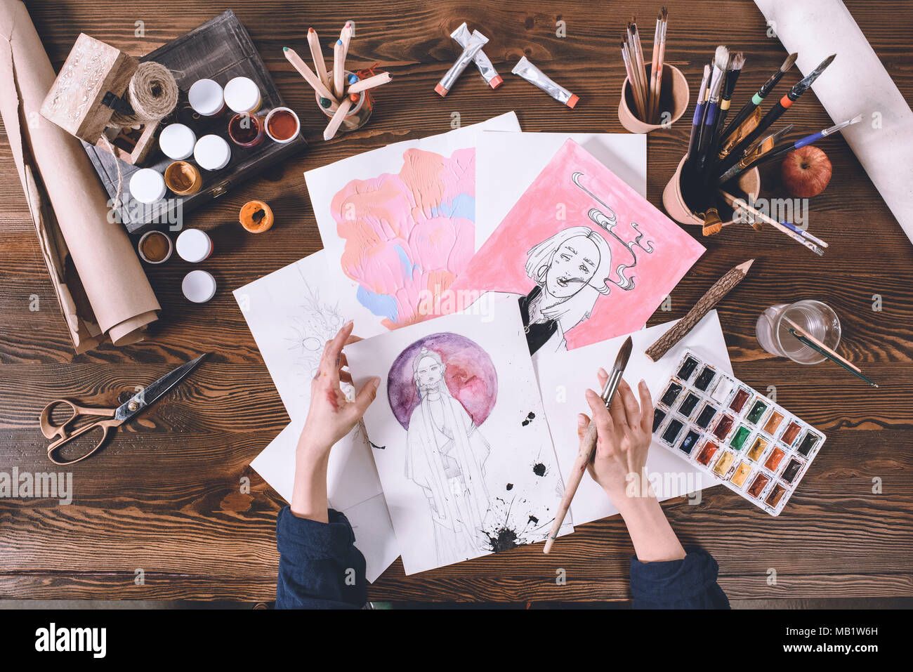 top view of artist painting with watercolor paints - Stock Image