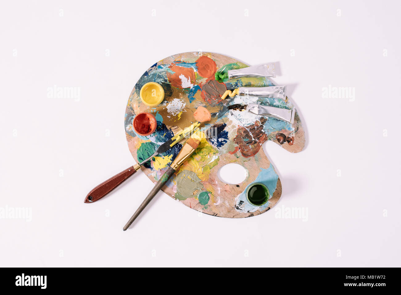 top view of palette with colorful paints isolated on grey  Stock Photo