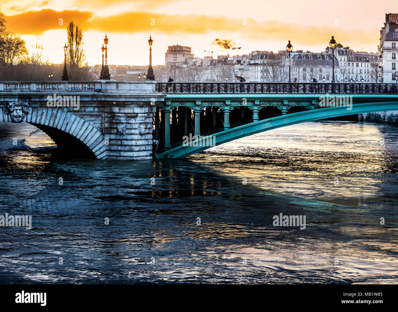 Pont Notre-Dame over the high Seine at sunrise during Paris flood of 2018; the road on the left is submerged - Stock Image