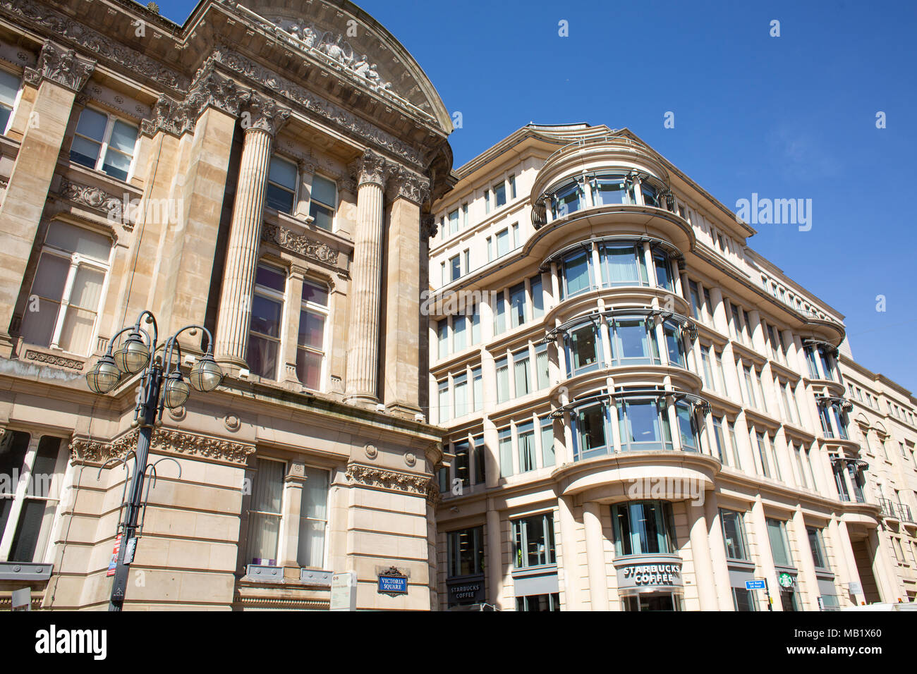 The view of the Lloyds Banking Building incorporating Starbucks café next to the Birmingham City Council in Colmore Row, Birmingham, England, UK - Stock Image