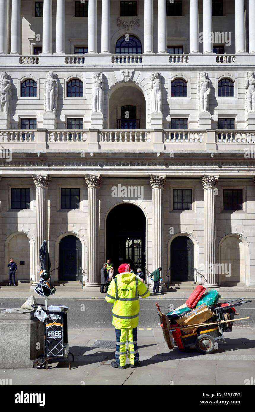 London, England, UK. Bank of England on Threadneedle Street and street cleaner in Hi Vis jacket - Stock Image