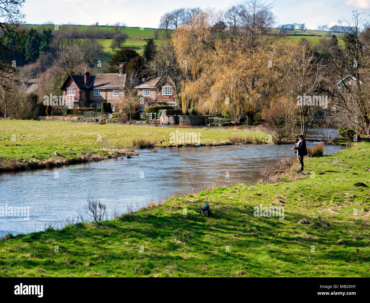 Peak District National Park. 5th Apr, 2018. UK Weather: fly fisherman enjoying the glorious sunshine on Thursday after the wet Easter Bank Holiday break at Ashford on the Water, near Bakewell in the Peak District National Park Credit: Doug Blane/Alamy Live News Stock Photo
