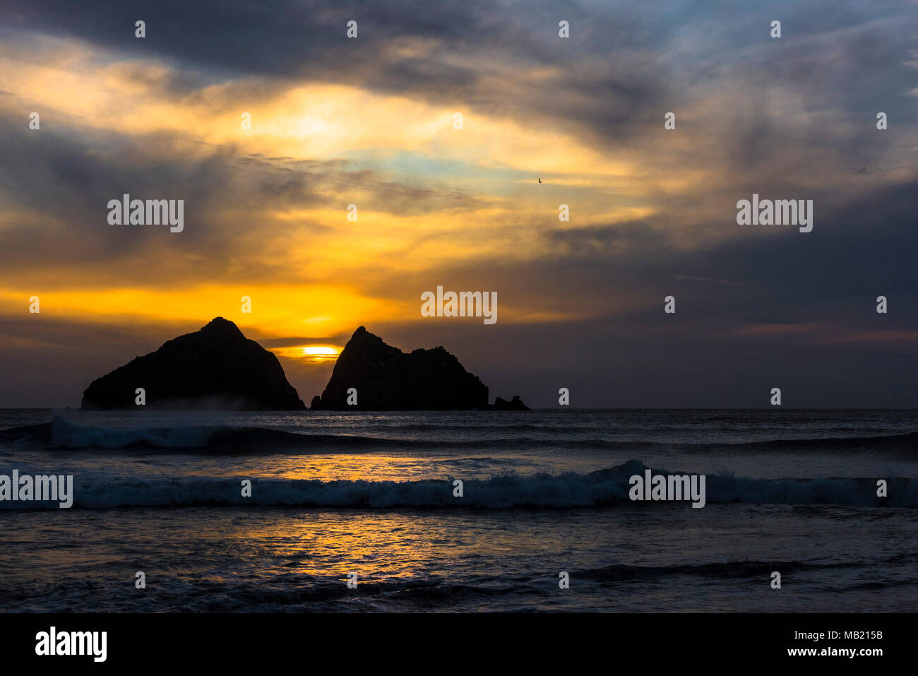 Holywell Bay, Cornwall, UK. 5th April 2018. UK weather - A beautiful sunset over the iconic Carter's Rocks at a deserted Holywell Bay in Cornwall.. Credit: Gordon Scammell/Alamy Live News - Stock Image