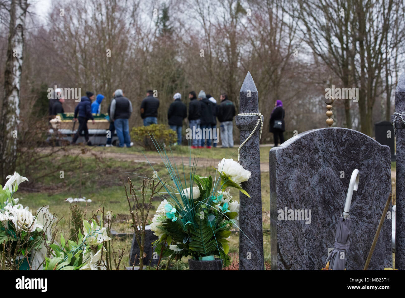 Grave coffin muslim stock photos grave coffin muslim stock images 15 march 2018 germany berlin attendees of a muslim funeral accompany the coffin izmirmasajfo Image collections