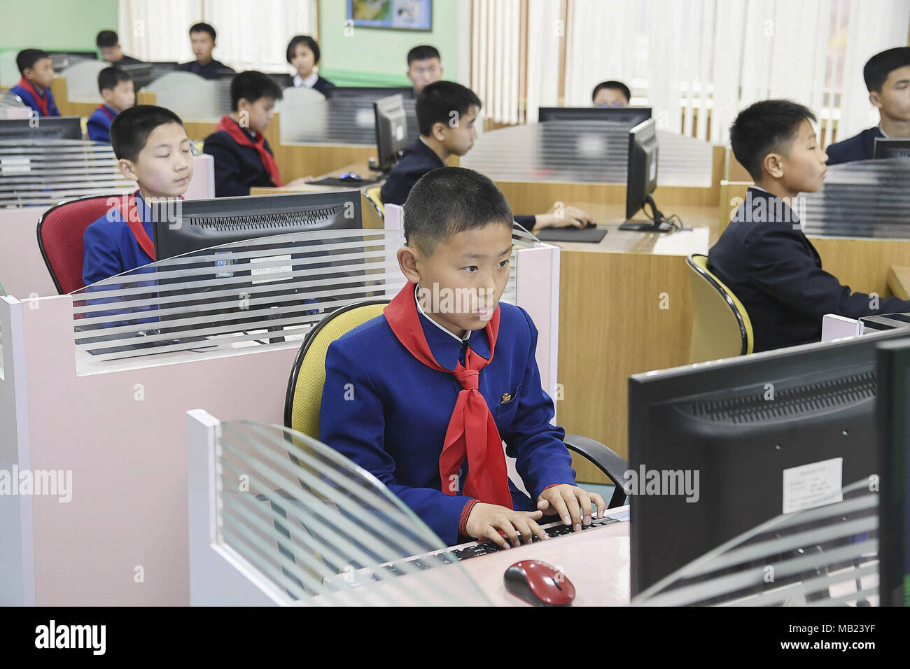 Pyeongyang, NORTH KOREA. 3rd Apr, 2018. March 3, 2018-Pyeongyang, North Korea-North Korean students at the Mankyungdae Boys ' Palace take IT classes. The date approaches, for better or worse. On April 27, the leaders from the two Koreas, technically still at war, will hold a summit at the border. The parties met today to work out security details. To hold talks with South Korean president Moon Jae-in, the leader of North Korea, Kim Jong-un, will take unprecedented steps for a man in his position literally. The summit will be held south of the military demarcation line in the truce village of Stock Photo