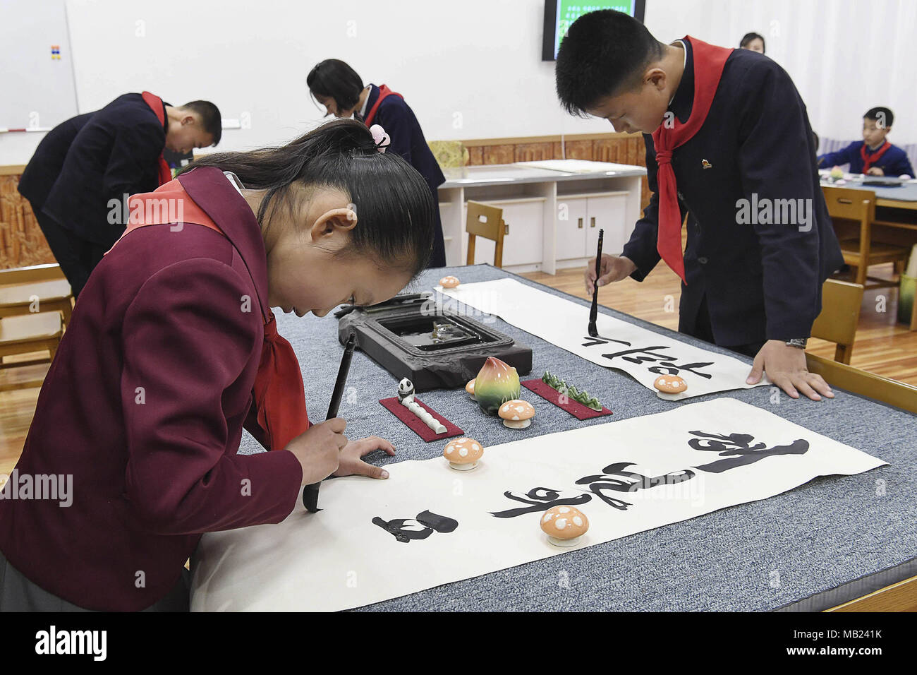 Pyeongyang, NORTH KOREA. 3rd Apr, 2018. March 3, 2018-Pyeongyang, North Korea-North Korean students at Mankyeongdae Boys ' Palace are taking Calligraphy classes. The date approaches, for better or worse. On April 27, the leaders from the two Koreas, technically still at war, will hold a summit at the border. The parties met today to work out security details. To hold talks with South Korean president Moon Jae-in, the leader of North Korea, Kim Jong-un, will take unprecedented steps for a man in his position literally. The summit will be held south of the military demarcation line in the truc Stock Photo