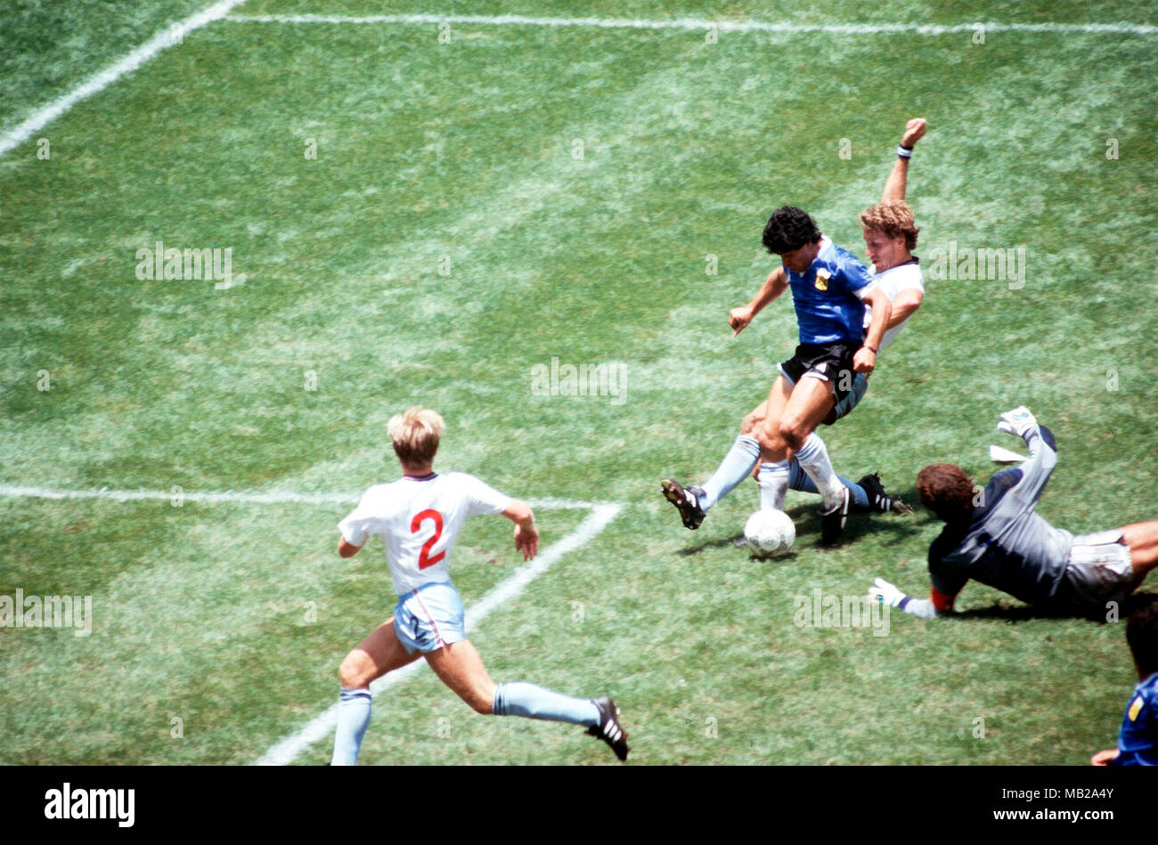 FIFA World Cup - Mexico 1986 22.6.1986, Estadio Azteca, Mexico, D.F. Quarter-final Argentina v England. Diego Maradona scores the greatest goal the World Cup has ever seen, 2-0 against England.  6 - Maradona has gone past gaolkeeper Peter Shilton and Terry Butcher is late, as Diego's lethal left foot slides the ball in to the net. England number 2 is Gary Stevens. - Stock Image