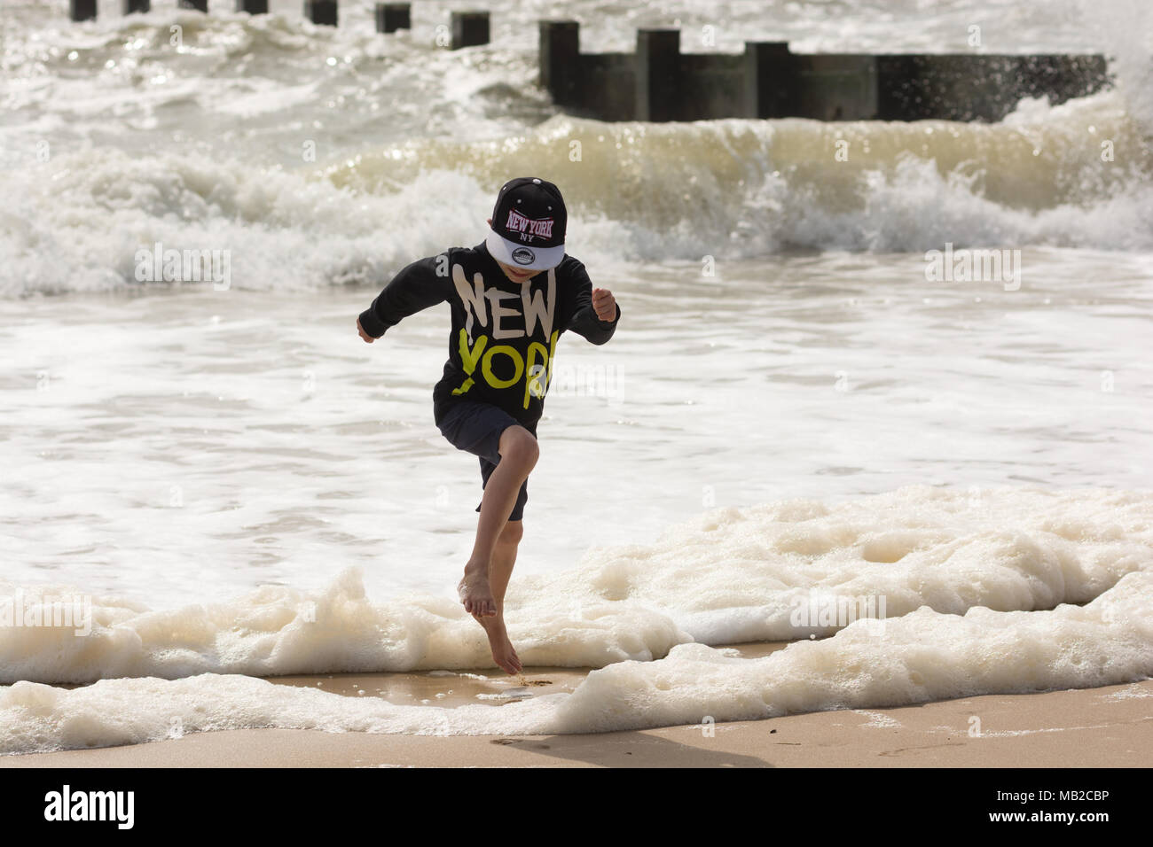 Child at boscombe beach stock photos child at boscombe beach stock boscombe bournemouth dorset uk 6th april 2018 uk weather warm negle Image collections