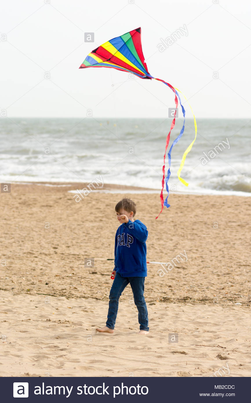 Flying kite on bournemouth beach stock photos flying kite on boscombe bournemouth dorset uk 6th april 2018 uk weather warm negle Image collections