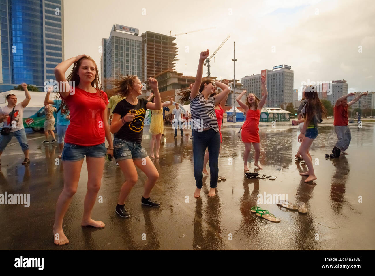 https://c8.alamy.com/comp/MB2F3B/minsk-belarus-may-9-2014-young-people-dancing-during-rain-in-front-of-the-palace-of-sports-MB2F3B.jpg