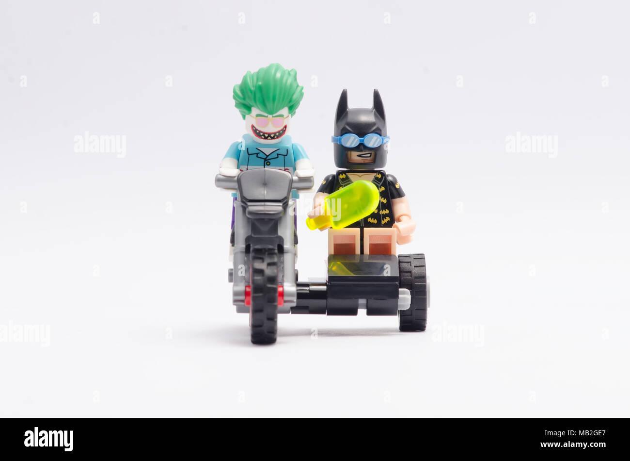 Lego Joker And Batman Riding Motorcycle Isolated On White Background
