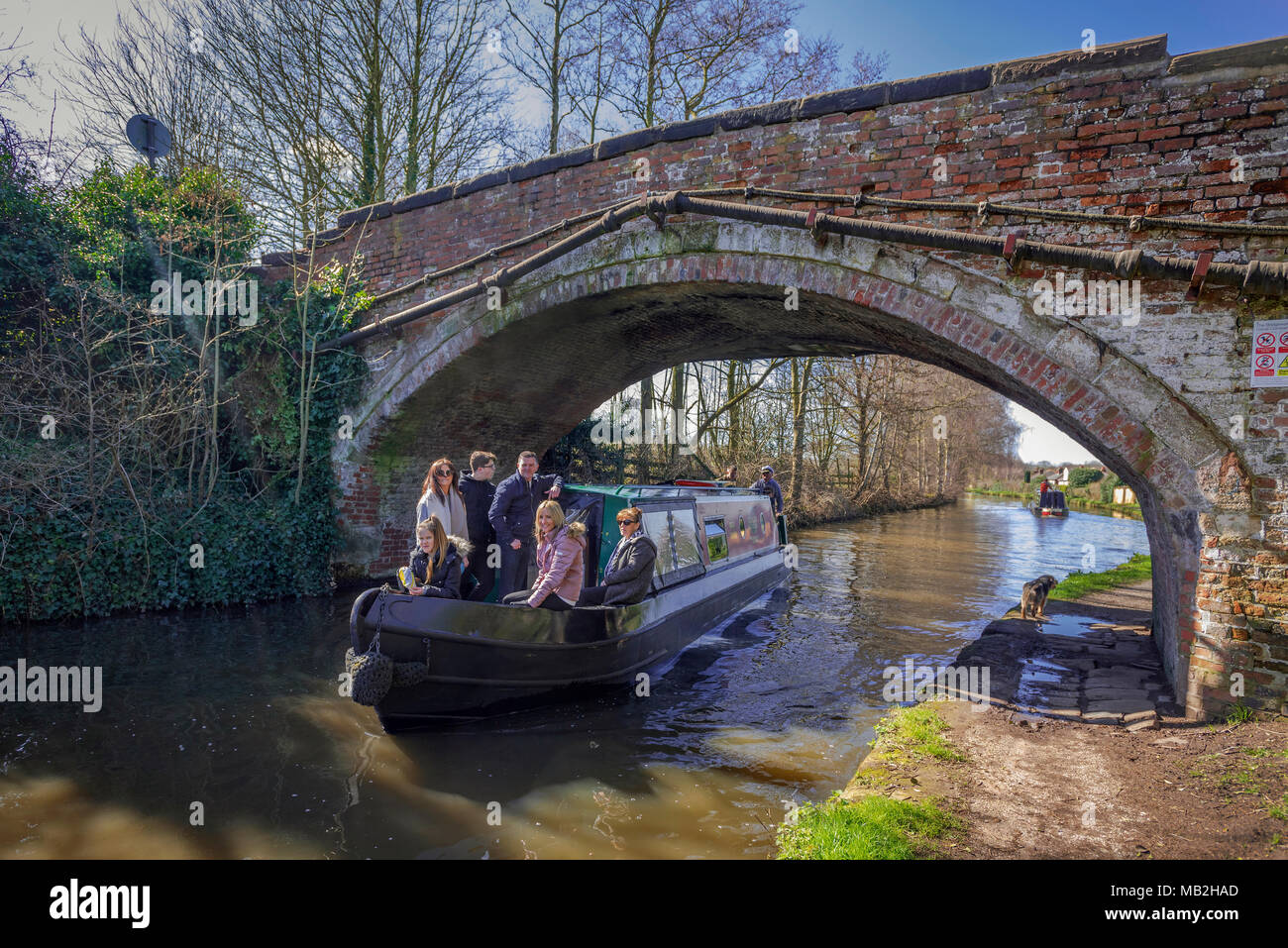 Canal narrowboat at Red Lane bridge on Bridgewater canal in Walton Warrington. - Stock Image