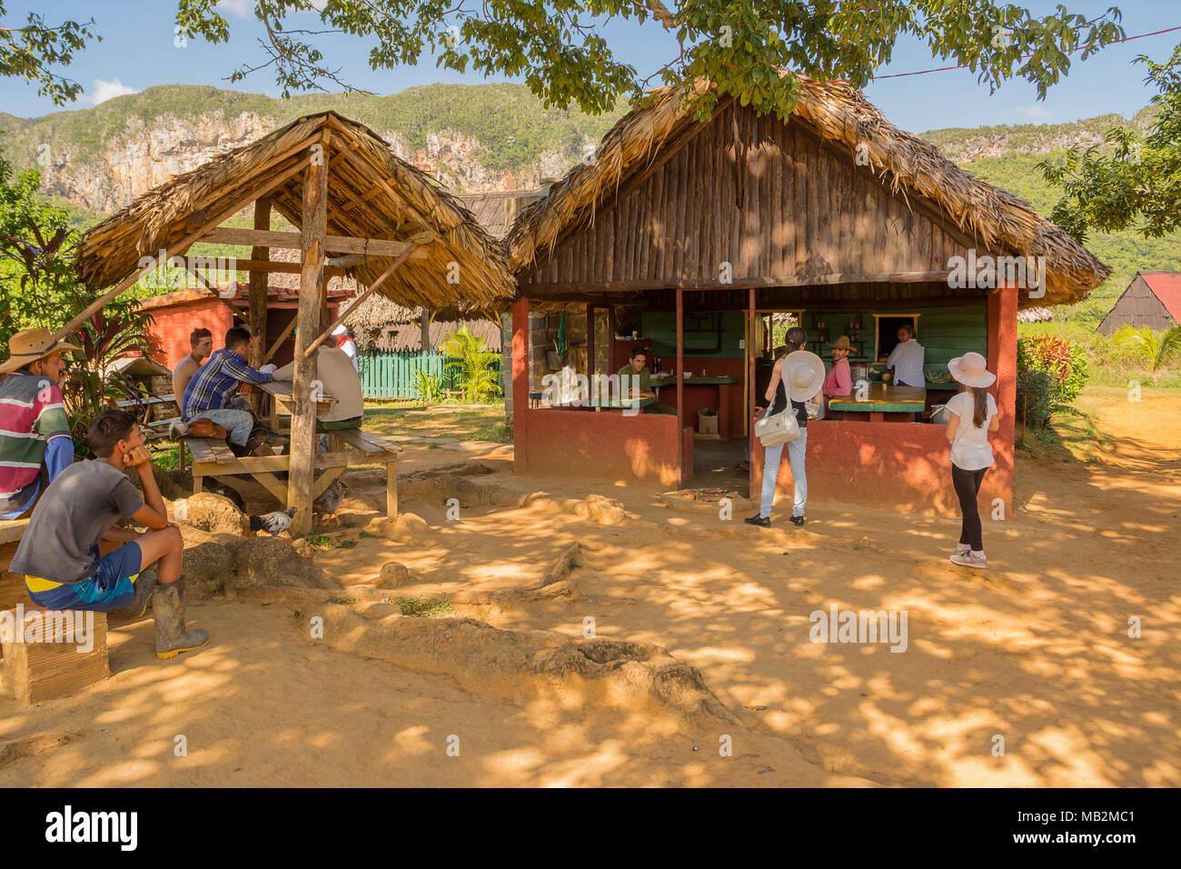 Vinales, Cuba - December 5, 2017: Cubans and tourists relaxing at farm bar - Stock Image