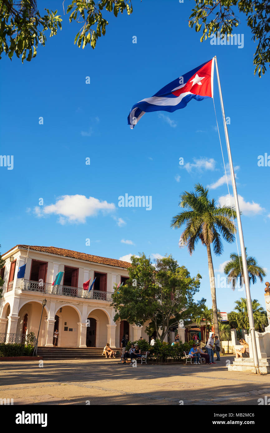 Vinales, Cuba - December 5, 2017: Square in front of the town hall of Vinales with people sitting on the bench - Stock Image