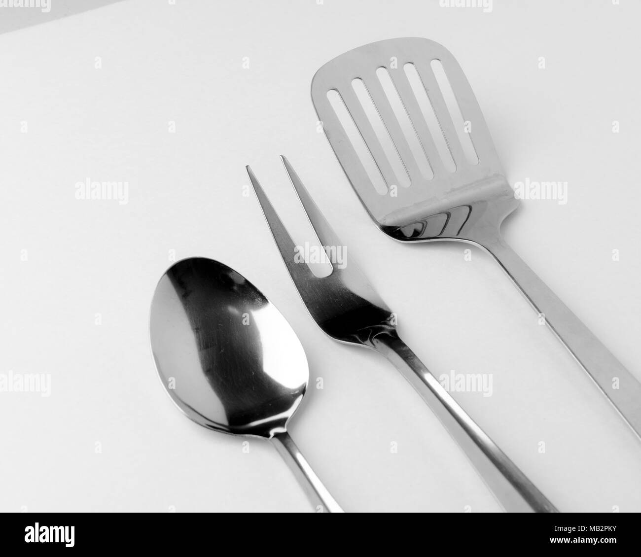 Kitchen Utensil Whisk Beater utensils used in kitchen to make food and projects - Stock Image