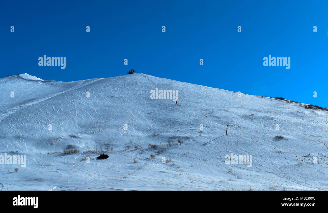 Arctic Valley Ski Club in the spring.  One last ride on the chair before summer - Stock Image