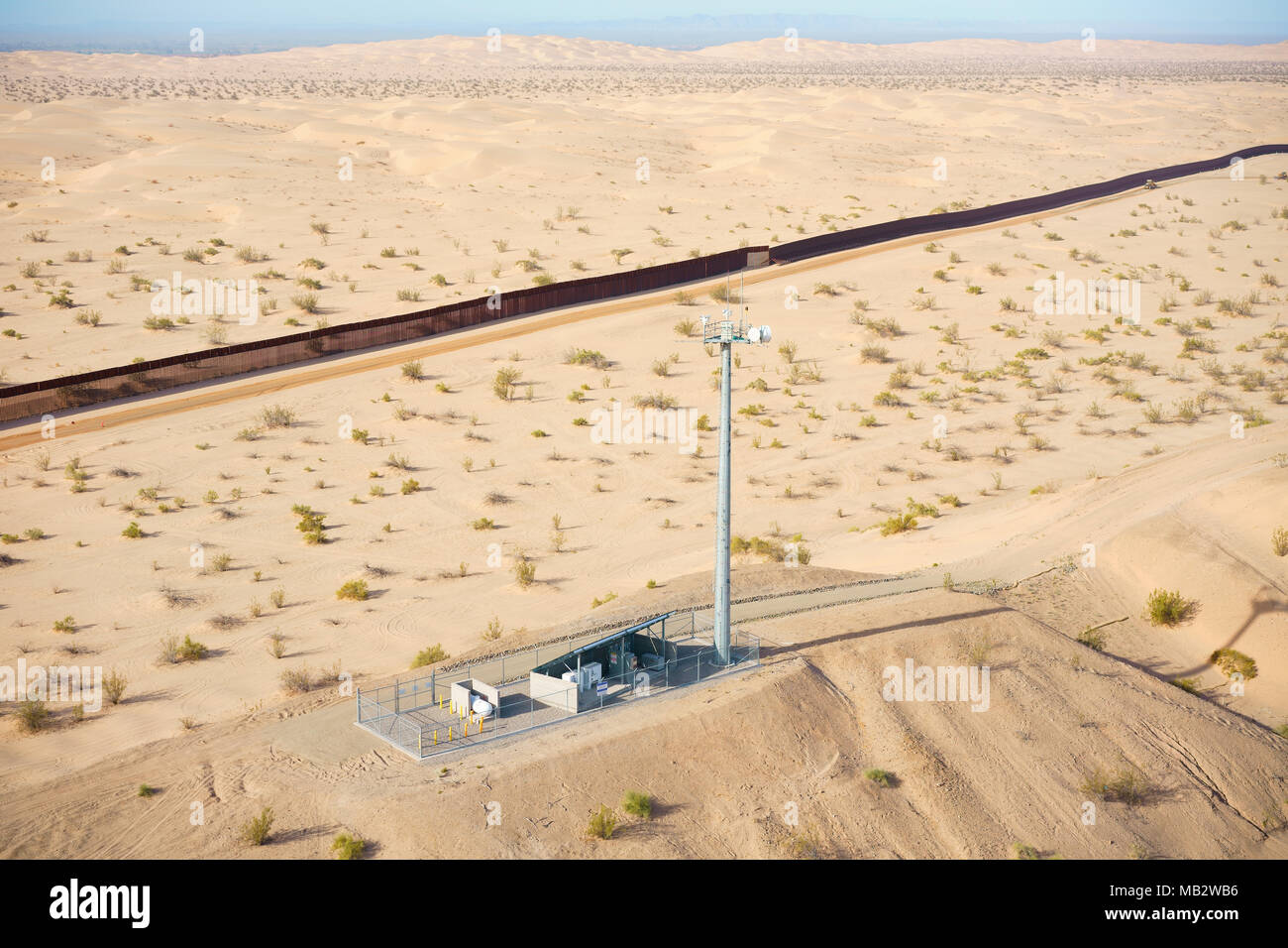 HIGH-TECH EQUIPMENT ON A MOUND USED FOR SURVEILLANCE OF THE MEXICO - US BORDER (aerial view). Algodones Sand Dunes in the Sonoran Desert. - Stock Image