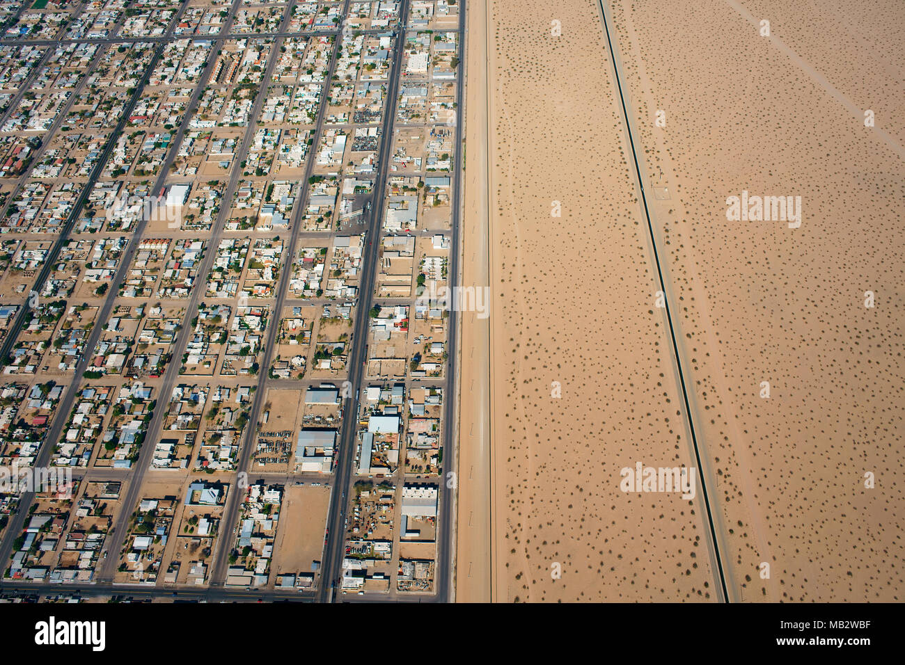 INTERNATIONAL BORDER: MEXICO - UNITED STATES (aerial view). City of San Luis Rio Colorado in Sonora, Mexico stretching alongside the U.S. Border. - Stock Image