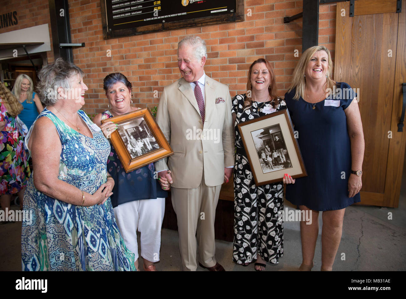The Prince of Wales meets four sisters he boarded with when he was 17, in Geelong, Victoria where he went to school, (Left to right) Penny Jenner, Jane Tozer, Amanda Boxhall and Lisa Lawlor during a tour of the Bundaberg Rum Distillery. - Stock Image