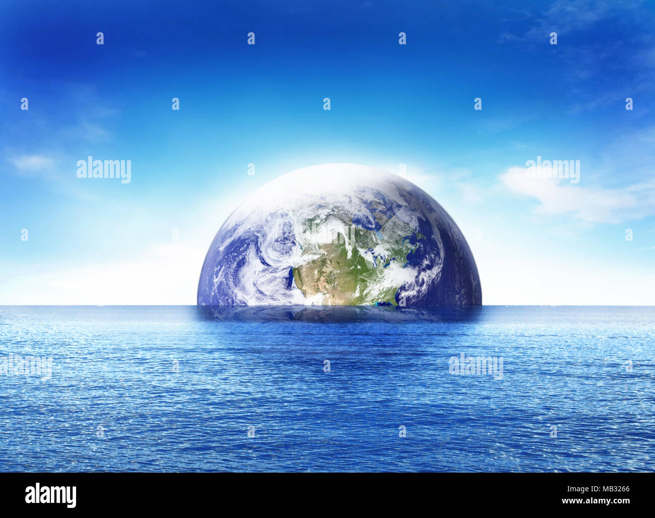 Birth of the world or doomsday scene, sinking earth globe or planet earth. Blue sea and beautiful world globe rising. - Stock Image