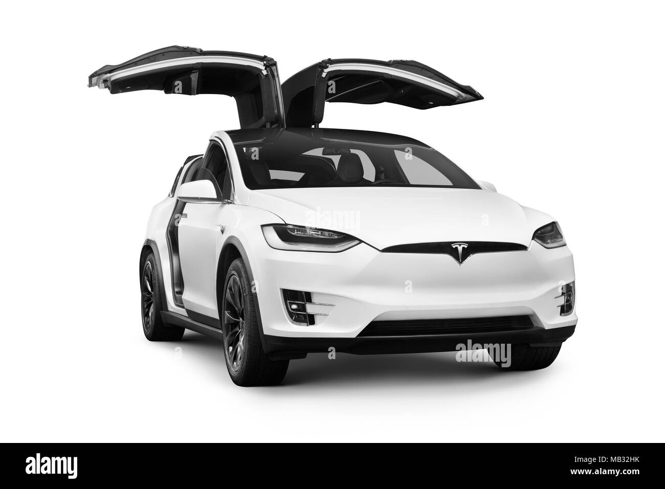 White Tesla Model X luxury SUV electric car with open falcon wing doors, 2018, isolated on white background - Stock Image