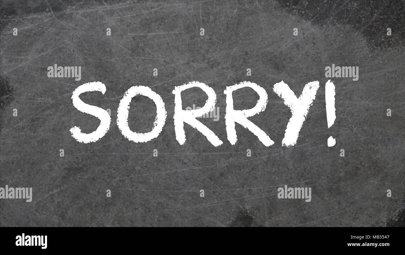 SORRY written in chalk on blackboard - Stock Image