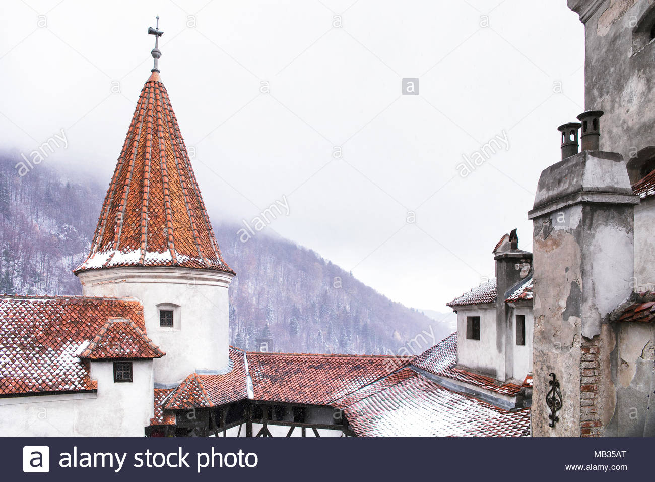 Bran Castle dusted with Winter snow in the valleys of central Romania. - Stock Image