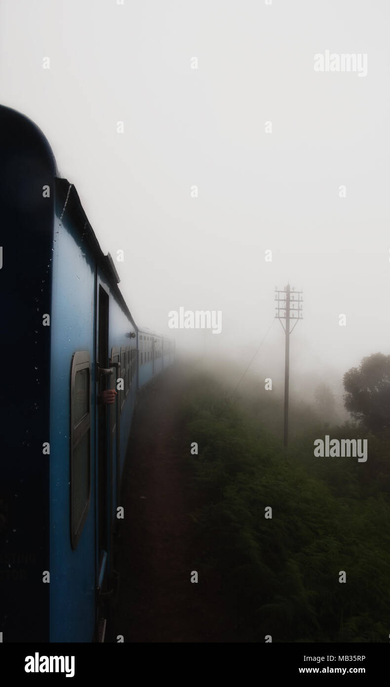 Travelling by train in the fog, Nuwara Eliya, Sri Lanka. - Stock Image