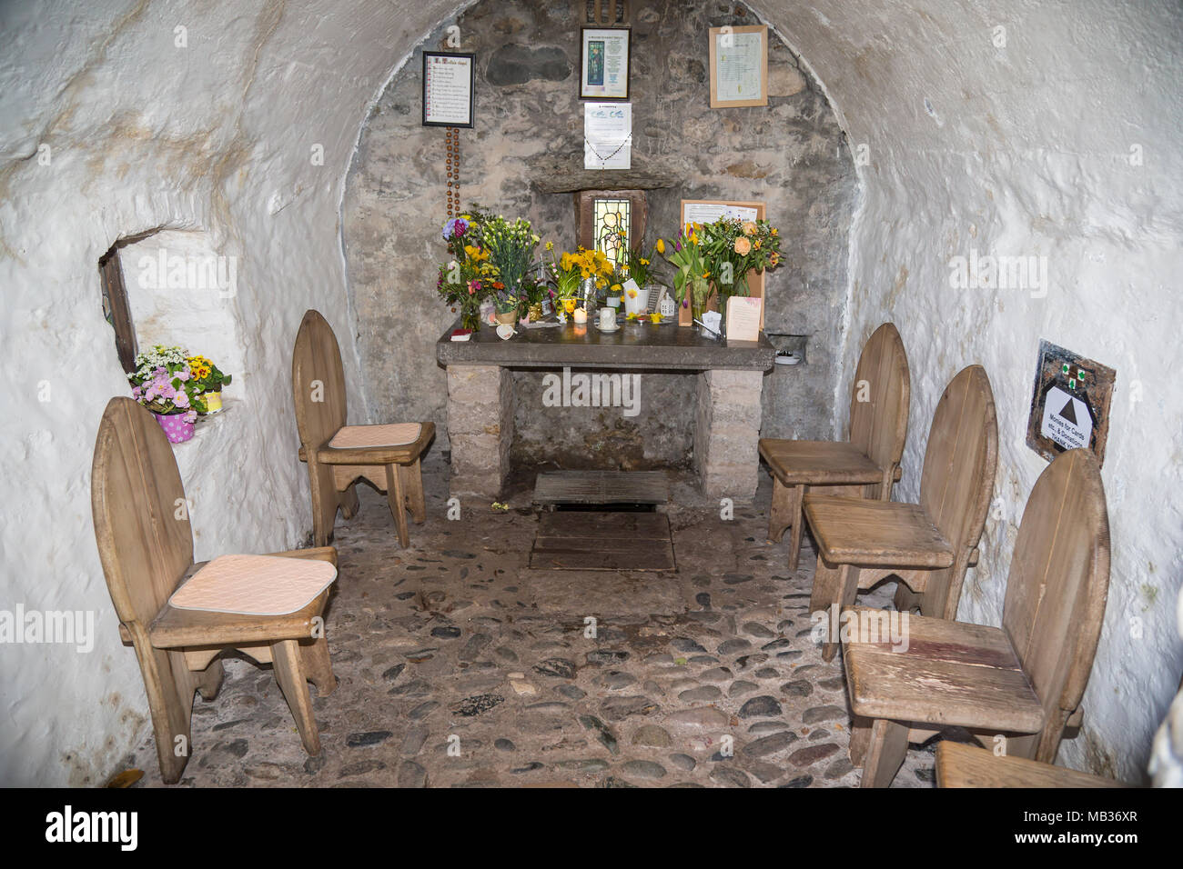 View inside the chapel of Saint Trillo, the smallest chapel in Britain at Rhos on Sea North Wales - Stock Image