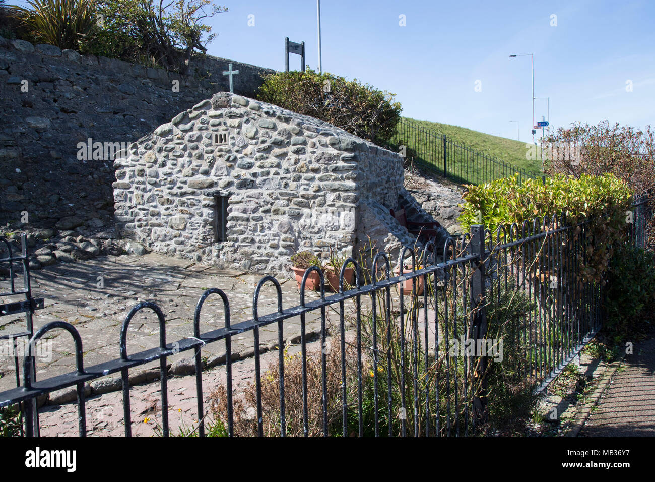 Saint Trillo's chapel at Rhos on Sea in North Wales is the smallest chapel in Britain and stands on the foreshore at Llandrillo yn Rhos Stock Photo