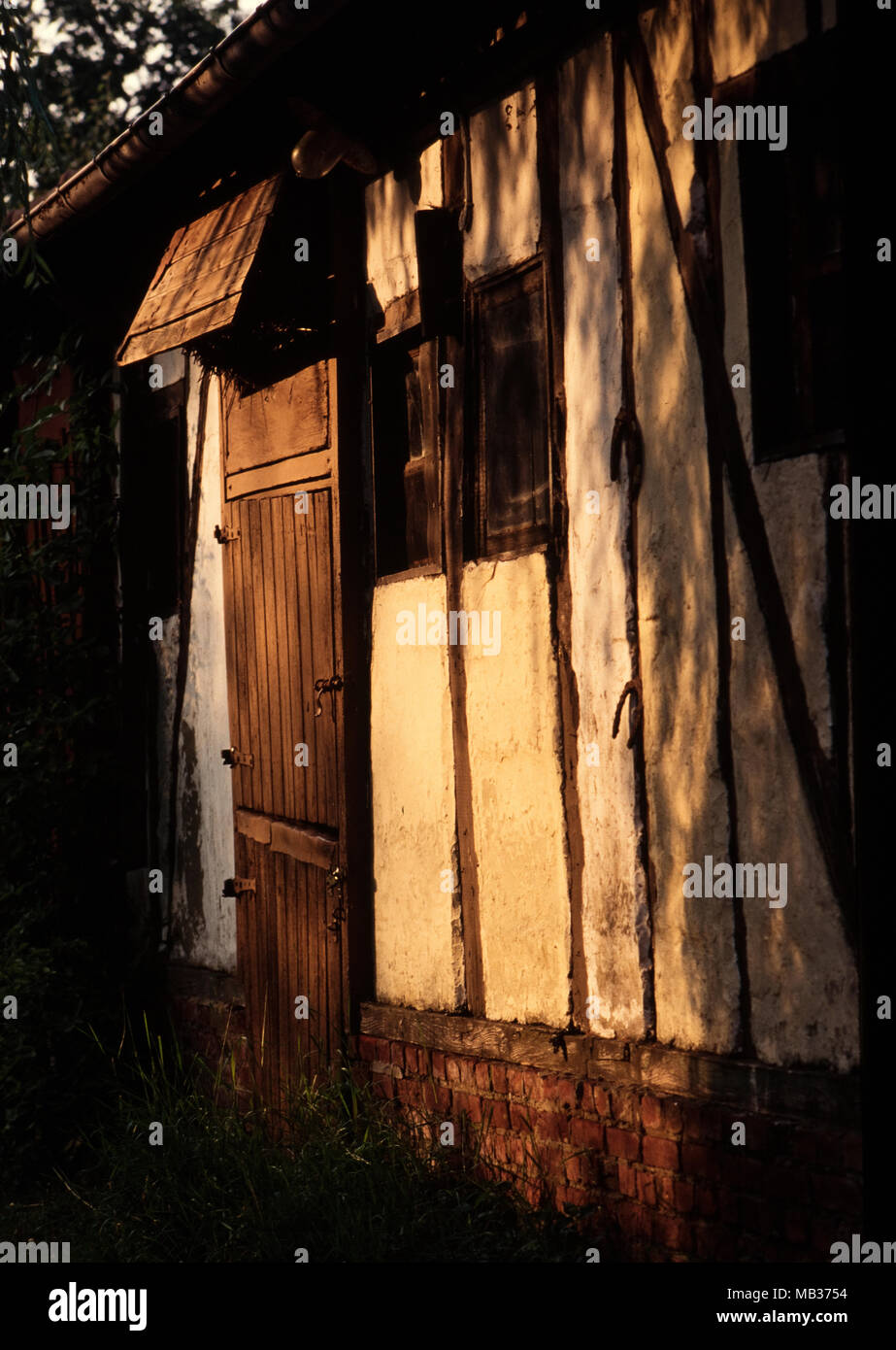 Barn Door in evening light,Normandy France. 2000 - Stock Image