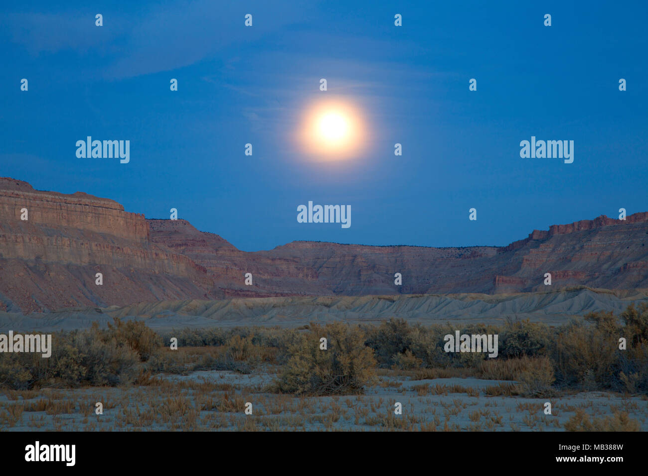 Moonrise over Book Cliffs, Emery County, Utah - Stock Image