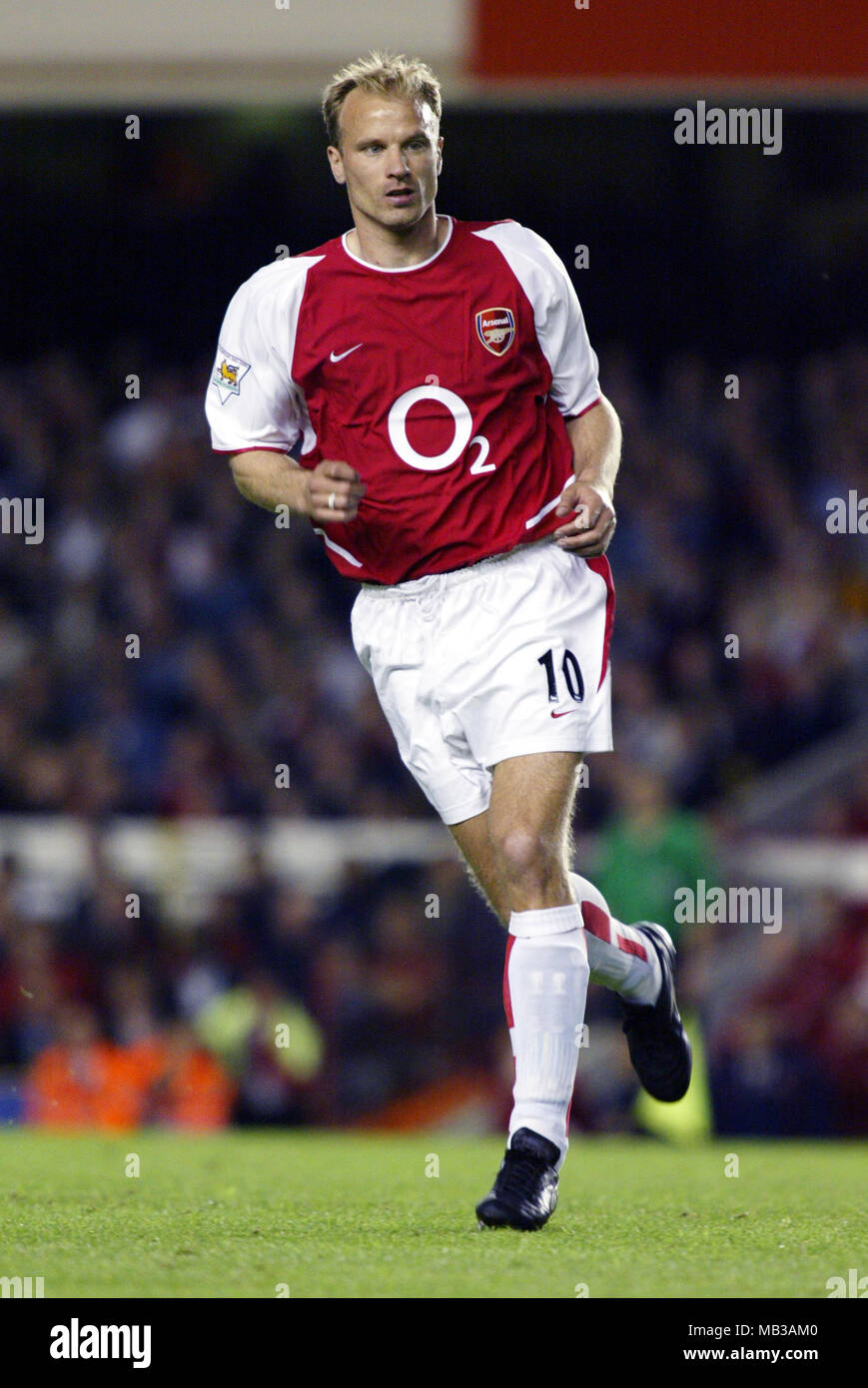 finest selection ab176 cc36c Dennis Bergkamp stock image playing for Arsenal wearing O2 ...