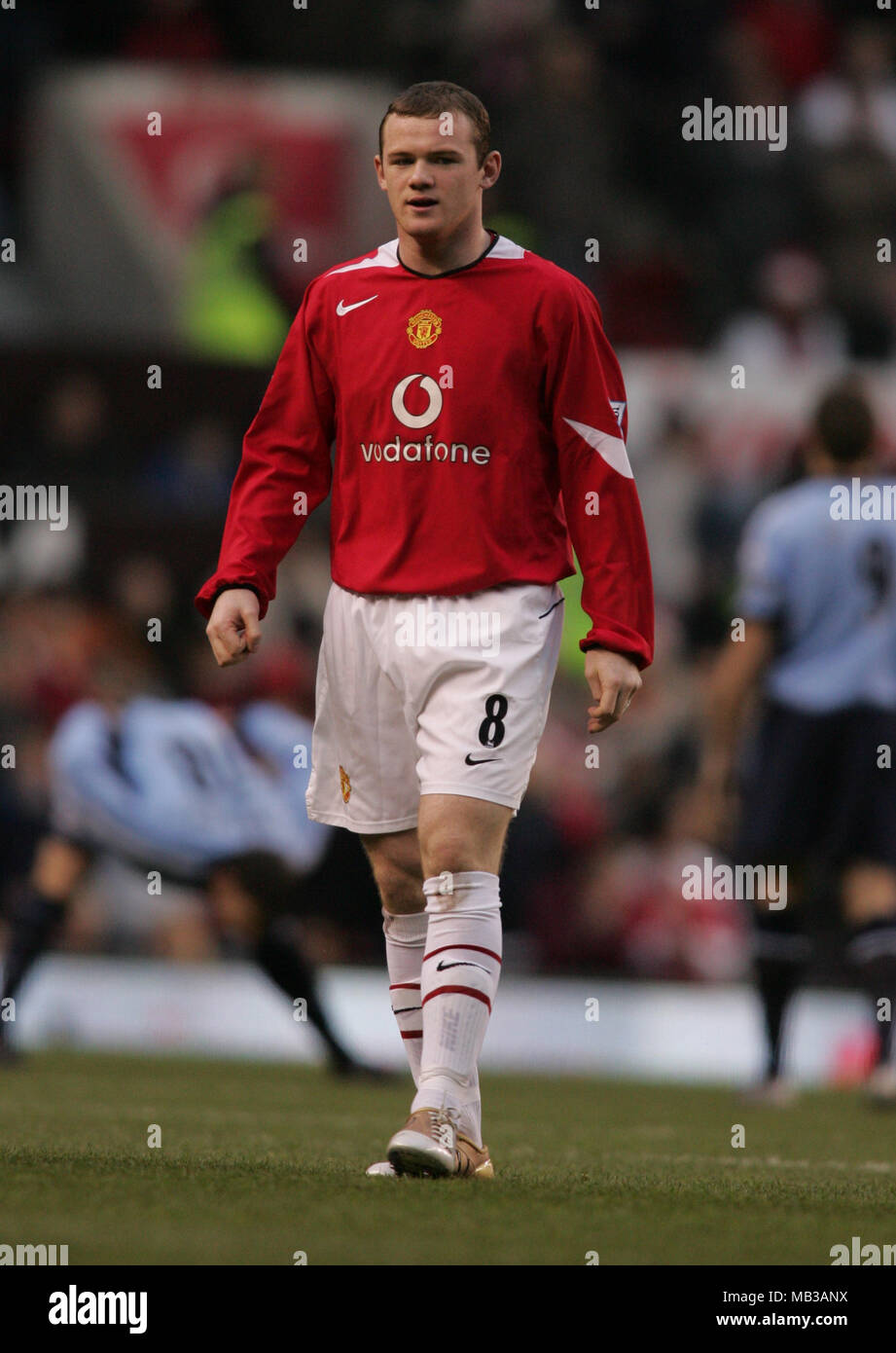 1ca1bf913ac Stock picture of Wayne Rooney playing for Manchester united in 2004 wearing  vodafone red kit.