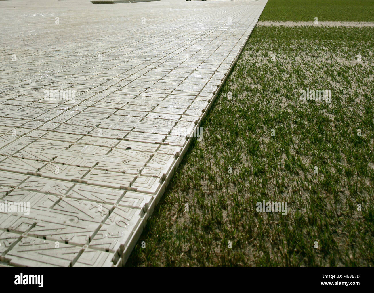 a temporary plastic flooring surface to cover a football pitch so