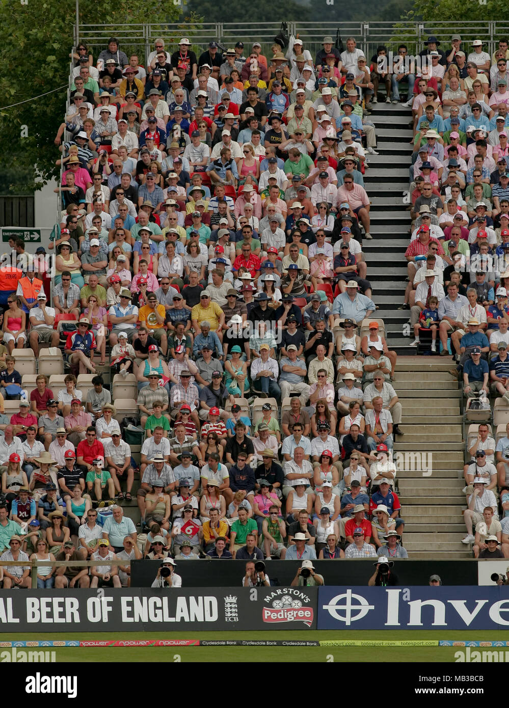 Blocks of fans at a twenty20 cricket match suitable for backgrounds use. - Stock Image